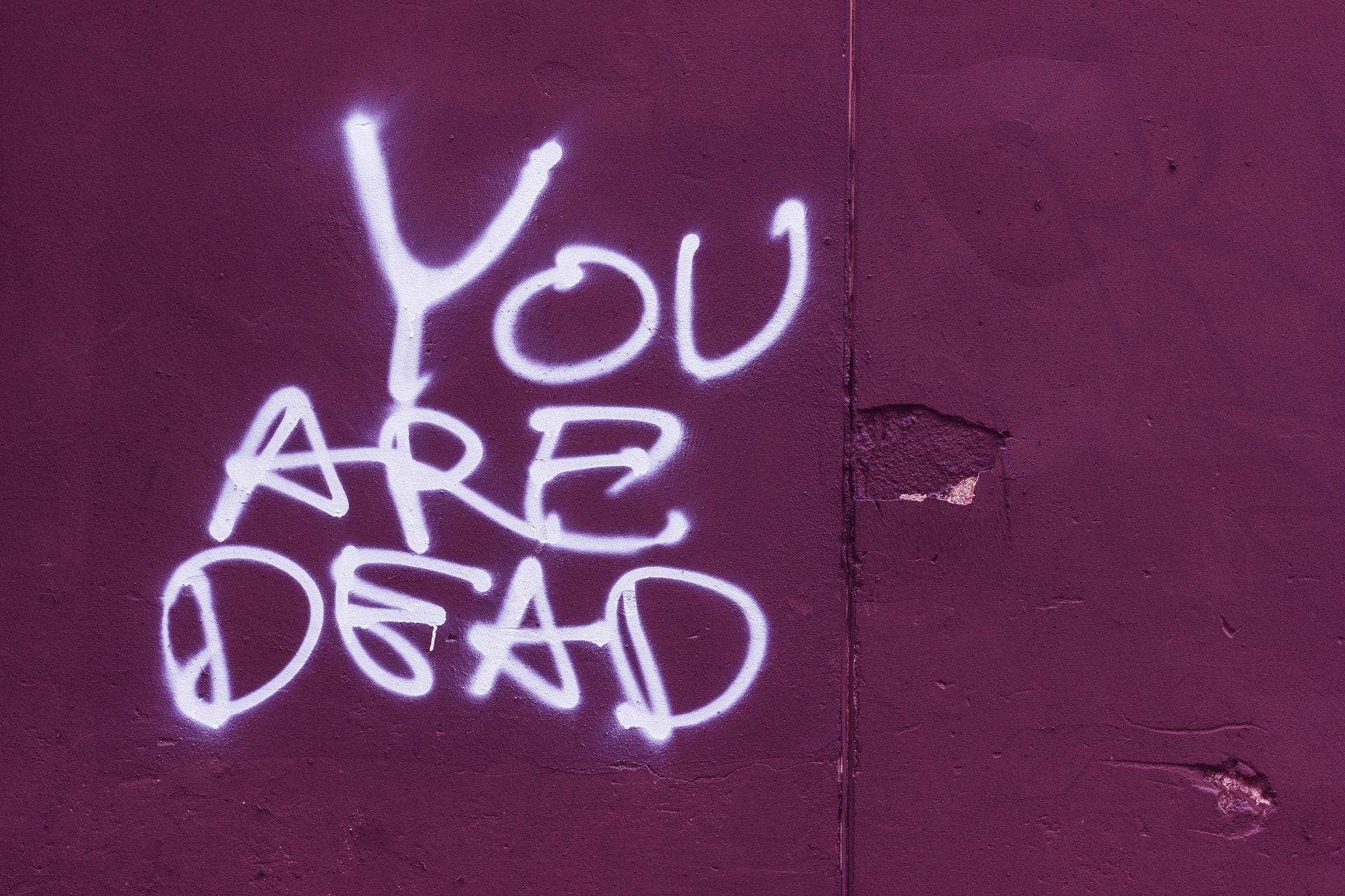 graffiti saying YOU ARE DEAD