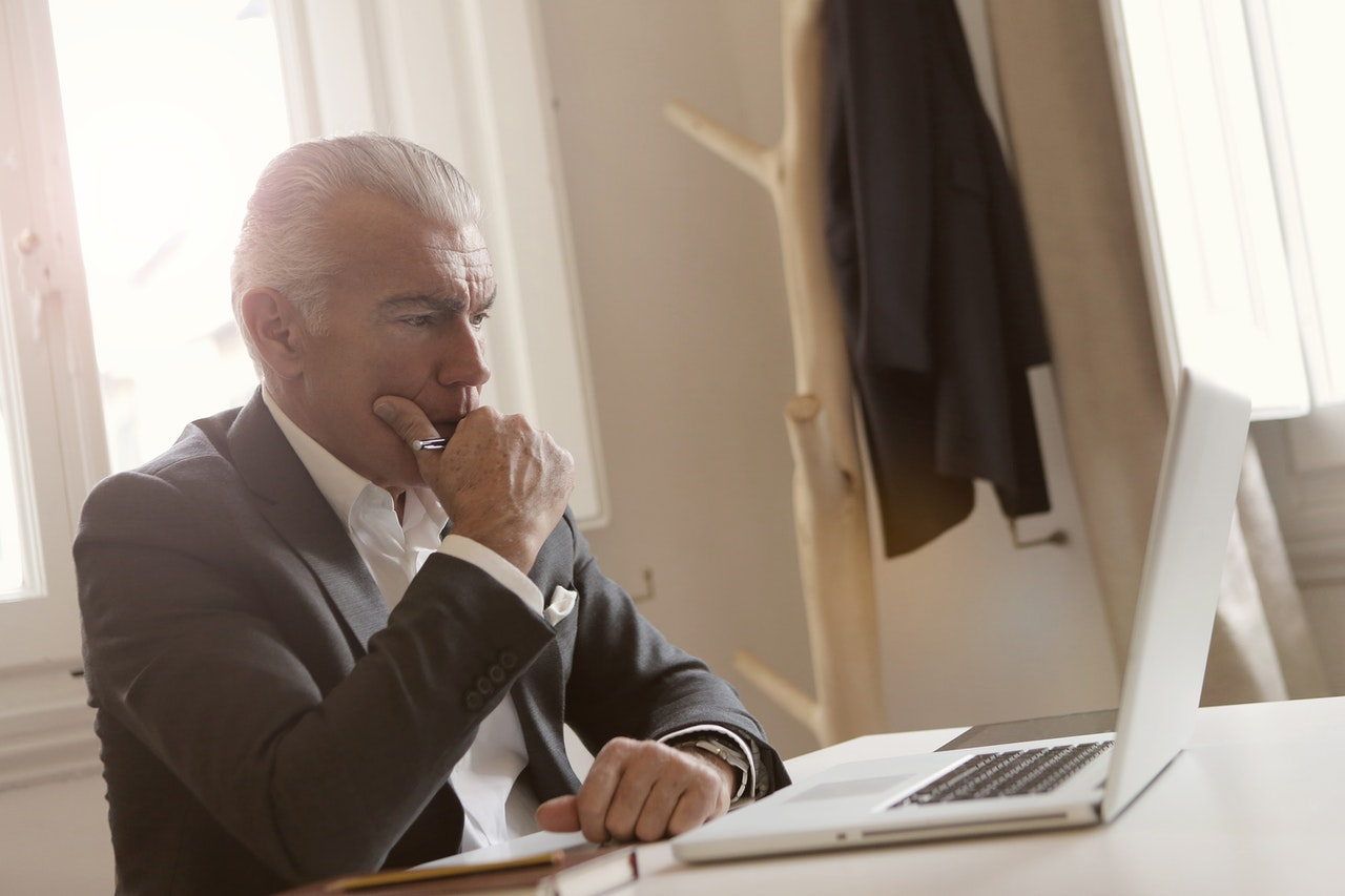 worried businessman in a home office